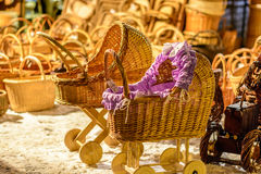 Straw children buggy, tractor and other straw souvenirs on Christmas market Stock Photo
