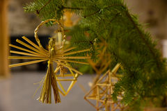 Straw Christmas tree decorations Royalty Free Stock Photo
