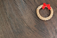 Straw Christmas wreath on a wooden texture. Straw Christmas wreath on a texture Stock Image