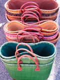 Straw colored bags. Straw colored handmade bags in a sunny day Royalty Free Stock Photos