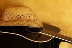 Straw Cowboy Hat på gitarren Royaltyfria Foton