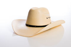 Straw Cowboy-Hut auf weißem Hintergrund Stockfotos