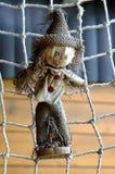 Straw doll in cobweb Royalty Free Stock Photos