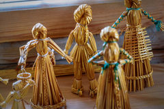 Straw doll. Vintage children`s toys handmade from dried straw Stock Photos