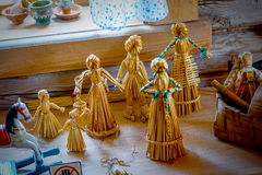 Straw doll. Vintage children`s toys handmade from dried straw Royalty Free Stock Images