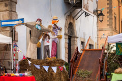 Straw Dolls At Chestnuts Festival Manziana Italy. MANZIANA, ITALY - OCTOBER 15, 2016: Straw dolls and other decorations in the main square of Manziana with the Royalty Free Stock Image