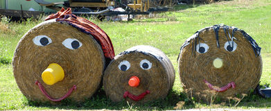 Straw family. A family made out of straw bales Stock Images