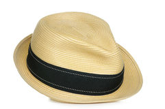 Straw Fedora. A tan straw fedora hat with a black stripe royalty free stock image