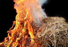 Straw fire with orange flames. Stock Photos