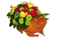 Straw frog full of flowers Stock Photo