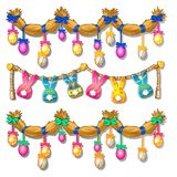 Straw garland with painted eggs and paper bunnies  Royalty Free Stock Images
