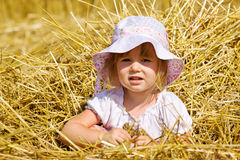 Straw girl Stock Images