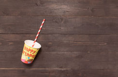 Straw and glass are on the wooden background Royalty Free Stock Photos