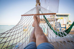 Straw hammock in balcony at tropical beach for relaxation Royalty Free Stock Photo
