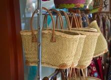 Straw handbags in store Stock Photos