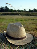 Straw hat. Landscape admission with straw hat Stock Photography