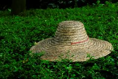Straw hat. This shot is of a straw hat. This style of hat is commonly seen on the heads of gardeners in China Stock Image