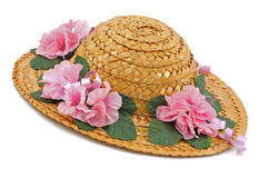 Straw Hat. With pink flower decorations royalty free stock images