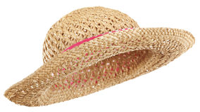 Straw hat. Isolated straw hat, pink band, tilted Stock Photo