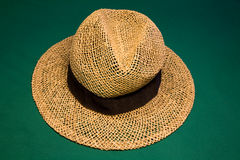Straw hat. On the green casino table royalty free stock photography