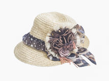 Straw hat with artificial flower Royalty Free Stock Photography