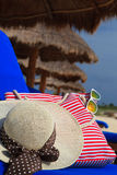 Straw hat, bag and sun glasses on tropical beach Stock Photo
