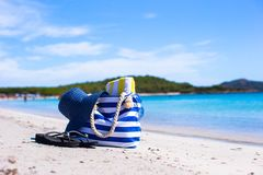 Straw hat, bag, sunglasses and towel on white Stock Photos