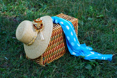 Straw hat, basket and neckerchief Royalty Free Stock Photo