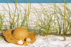 Straw hat at the beach Royalty Free Stock Image