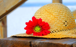 Straw Hat on Beach Boardwalk Stock Images