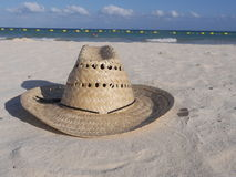 Straw hat at the beach Stock Photos