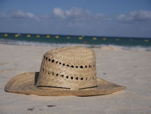 Straw hat at the beach Stock Image