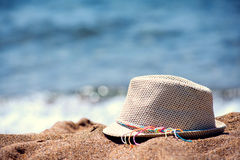 Straw Hat on the Beach with much Copy Space Royalty Free Stock Photography