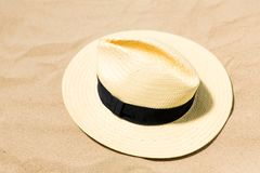 Straw hat on beach sand royalty free stock images