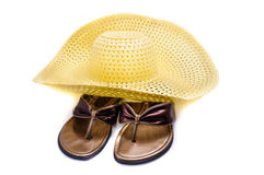 A straw hat and beach shoes Stock Photography