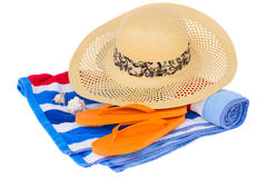 Straw hat and beach towel Stock Photo