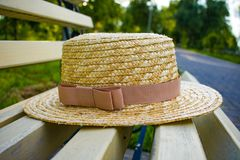 Straw hat on the bench stock photography