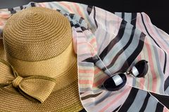 Bow Straw Hat, Foulard and Sunglasses. Straw hat with a big bow, a pink and black foulard and a pair of sunglasses stock photo
