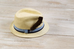 Straw Hat with Bird Feather on Faded Wood Stock Photography