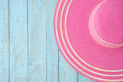 Straw hat  on blue wood.Summer holiday background concept Royalty Free Stock Photos