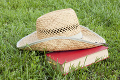 Straw hat with a book Stock Photo