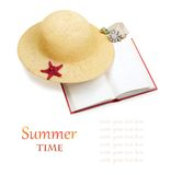 Straw hat with book and red starfish isolated Stock Photography