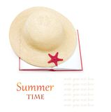Straw hat with book and red starfish isolated Royalty Free Stock Photography