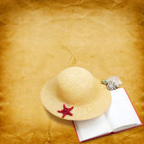 Straw hat with book and red starfish Stock Photography