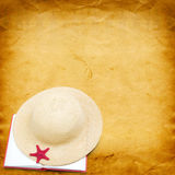 Straw hat with book and red starfish Royalty Free Stock Photo