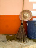 Straw hat and broom Stock Image