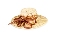 Straw hat with brown bowknot Stock Images