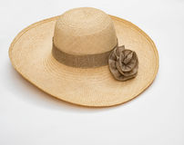 Straw Hat with Taupe Ribbon. Woven, woman's, straw hat with taupe ribbon & ribbon rosette isolated on white background Stock Photos