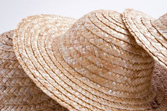 Straw hat collection. And abstract group of hats stock images