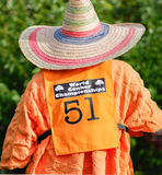 Straw hat. Contestants draw attention to themselves at the world conker championships in Southwick, near Oundle, England on 12 october 2014 stock photos
